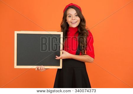 Spread Your Publicity. Happy Kid Hold Blank Blackboard For School Publicity. Little Child Smile With