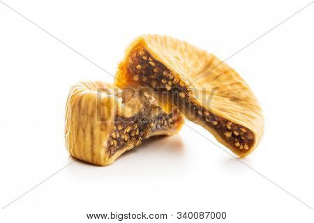 Sweet dried figs isolated on white background.