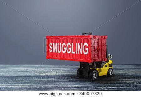 A Forklift Truck Carries A Red Container Labeled Smuggling. Transportation Of Illegal Prohibited Goo