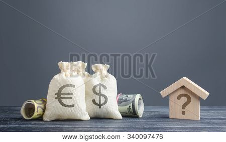 Money Bags And A House With A Question Mark. Cost Estimate. Solving Housing Problems, Deciding Buy O