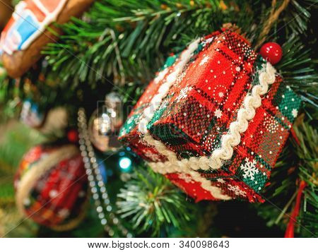 Hand Made Decoration For Christmas Tree. Decoration Made Of Tartan Fabric With Spangles For New Year