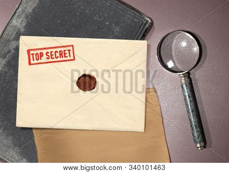 dorsal view of military top secret envelope with magnifier
