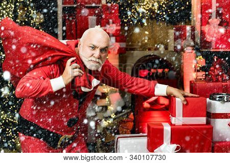 Thief Stole New Years Presents. Criminal Christmas. Criminal Santa Claus Posing With A Bag Of Christ