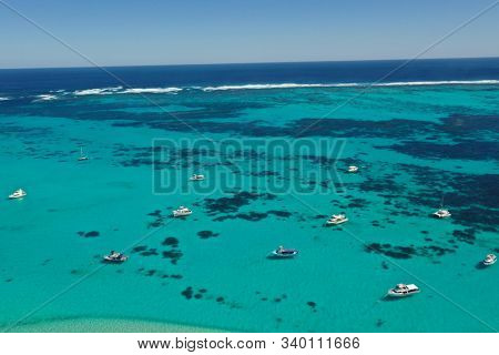 Boats and yachts moored off Coral Coast in Western Australia