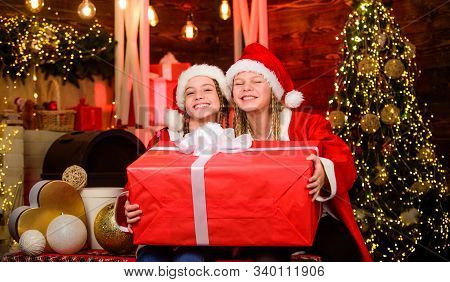 Winter Masquerade. Happiness And Joy. Girls Friends Sisters Santa Claus Costumes Received Gift. Sant