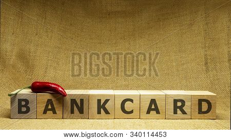 Wooden Cubes With Word Bankcard On Sackloth Background. Business And Bank Concept
