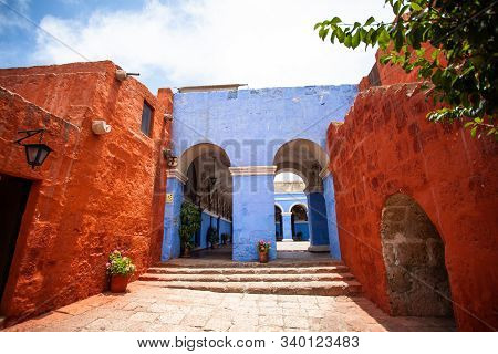Red And Blue Walls In The Monastery Of Saint Catalina, Arequipa, Peru. Without People..