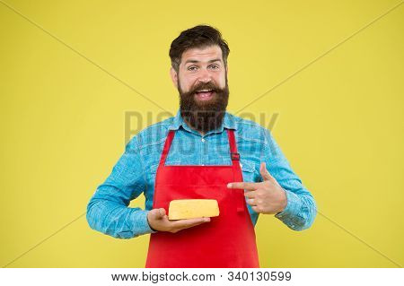 Reasonable Price And Good Quality. Cheesemaking Techniques. Cheese Maker. Hipster With Beard In Chef