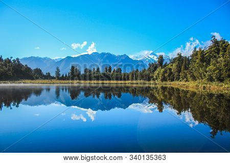 View Of Lake Matheson And Southern Apls, South Island, New Zealand