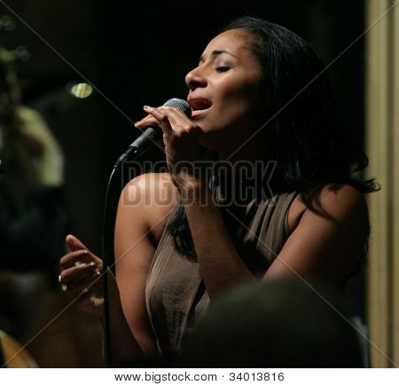 MADISON, NJ - JUNE 16: Andromeda Turre sings Funny Valentine as she performs with her father and his band, the Steve Turre Quartet, at Shanghai Jazz on June 16, 2012 in Madison, NJ.
