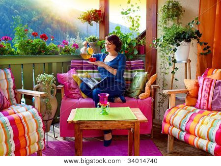 woman enjoying her comfortable terrace