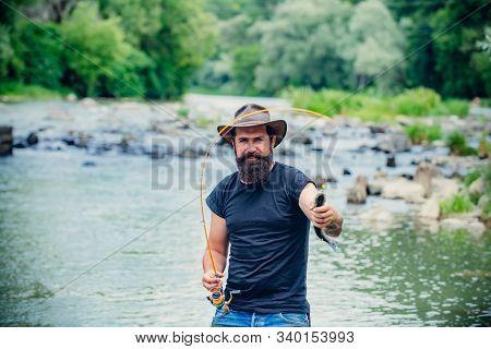 Portrait Of Cheerful Bearded Man Fishing. Fisher Fishing Equipment. Fishing Skills. Elegant Bearded