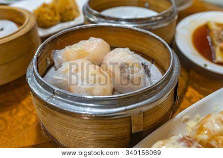Steamed Stuffed Shrimp Dumpling In Dimsum Bamboo Steamer Box