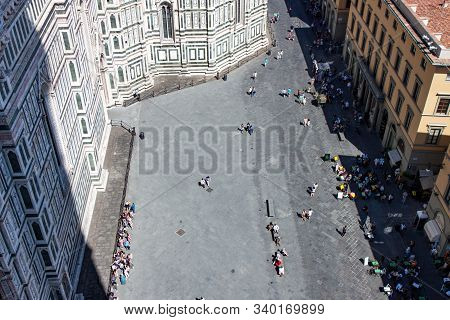 View From The Bell Tower In Florence Down To People In The Square