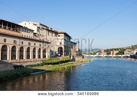 View Along The Arno River From The Ponte Vecchio In Florence