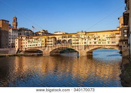 Ponte Vecchio Bridge With Reflection At Sunset In Florence
