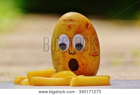 Potato French Fries And Potato With Human Face And Like Wondering To See The Fires
