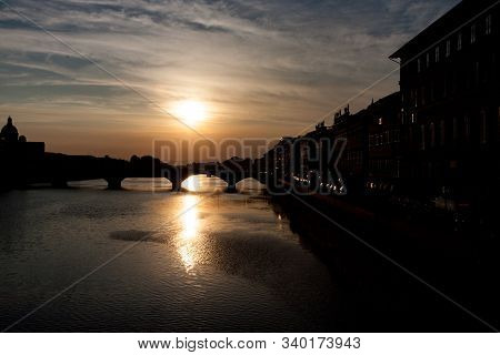 Silhouette Of Bridge On Arno River In Florence