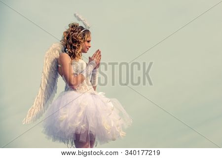 Angel Child Girl With Curly Blonde Hair - Innocent Girl Concept. Teenager Cherub Cupid. Child With A
