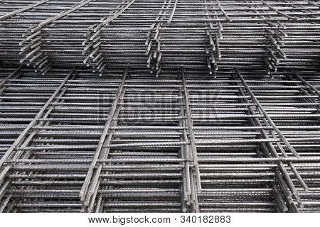 Rebar, reinforcing bars or steel close up, reinforcement steel, wires mesh of steel used as a tension device in reinforced concrete poster