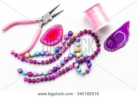 Purple, Pink, Rose Beads And Agate Druses For Jewelry Making On White Background. Hobby, Handmade, F