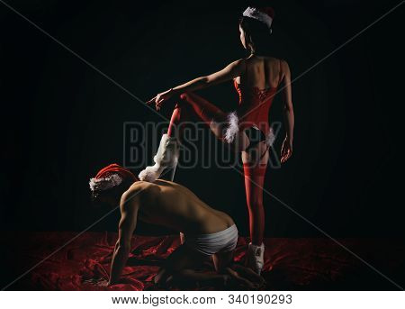 Bdsm Games With Domination And Submission. Young Naughty Lady With Santa Hat Sitting On Top Of Her L