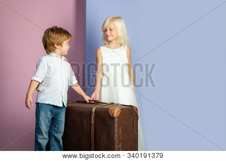 We Are Moving On. Relocation Concept. Couple Kids With Suitcase. Happy Childhood. Boy And Girl Cute