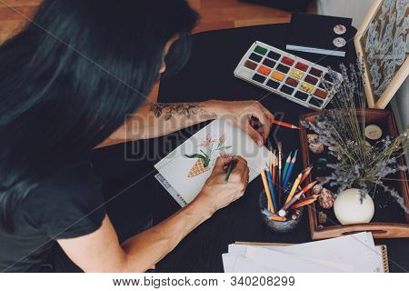 Sketchbook Art, Artist Inspiration, Tattoo Design. Woman Artist Draws Flower For Tattoo Sketch On Ta