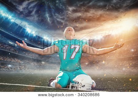 American Football Player Celebrating After Scoring A Touchdown On The Field Of Big Modern Stadium Wi