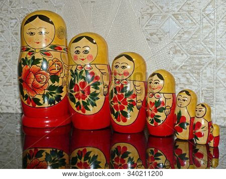 Matryoshka-russian Folding Doll Made Of Wood, Inside Which There Are Dolls Of Smaller Size. Semenovs