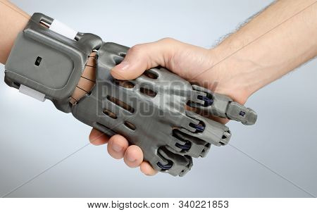 Hand With Prosthesis Printed On Fdm 3d Printer, Handshake Of The Prosthesis And A Healthy Hand On An