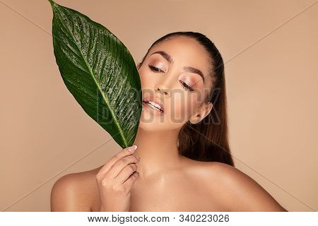 Beauty Face Of Young Beautiful Woman With A Fresh Healthy Skin. Skin Care Concept. Beauty Treatment.