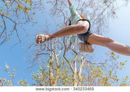 Woman Jumping Or Crossing Step Over In Forest