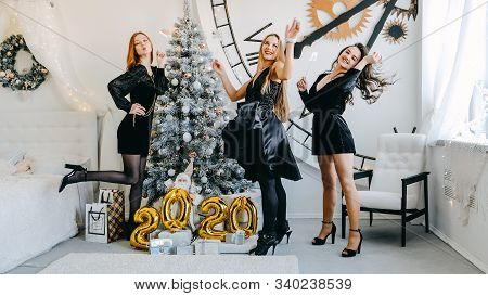 New Year Eve 2020 Party Celebration. Beautiful Women Celebrating New Year 2020. Three Happy Girls In