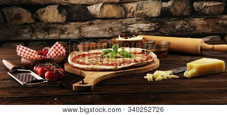 Pizza With Tomatoes, Mozzarella Cheese And Basil. Delicious Italian Pizza On Wooden Pizza Board. Ita