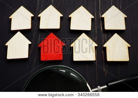 Real Estate Appraisal Concept. Red Home Model And Magnifying Glass. House Hunting.