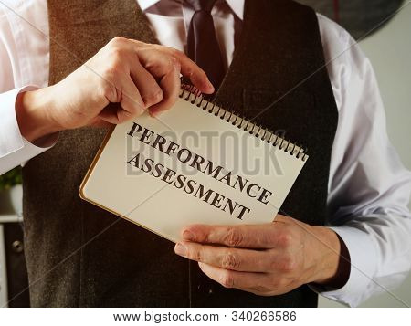 Performance Assessment In The Hands Of A Man.