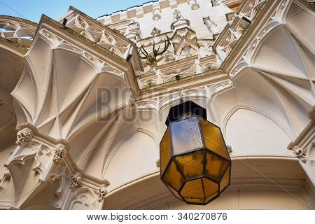 Glass Lantern Under The Arches Of Balcony On The Wall Of An Ancient Castle
