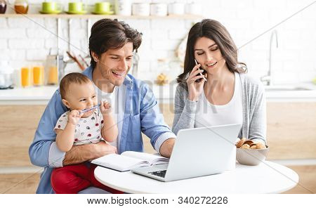 Family Business. Partners Spouses Working From Home, Consulting Clients Online At Kitchen