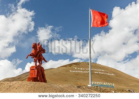 Chui Area, Kyrgyzstan - October 07, 2019: Monument To Manas And The State Flag Of Kyrgyzstan. Epic O
