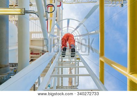 Offshore Oil Rig Operator Climbs Up To The Top Of Gas Processing Plant For Check Abnormal Condition
