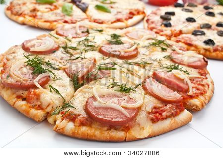 sliced pizza with sausage and onion