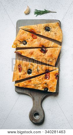 Traditional Italian Focaccia With Tomatoes, Olives And Rosemary - Homemade Flat Bread Focaccia.