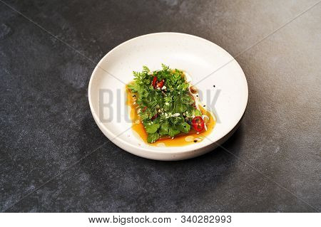 Smashed Cucumbers Plate With Red Chili Pepper Garlic Parsley And Vegetable Oil