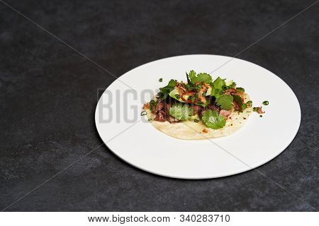 Mexican Tacos With Beef, Tomatoes, Avocado, Chilli And Onion