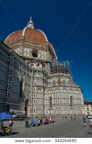 Florence, Italy - June 5, 2019 : The Cathedral of Santa Maria del Fiore was begun in 1296 in the Gothic style to a design of Arnolfo di Cambio and was structurally completed by 1436, with the dome designed by Filippo Brunelleschi.