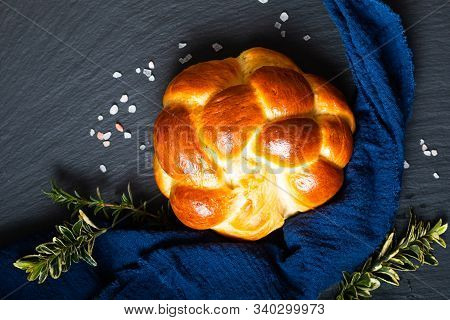 Homemade Food Concept Fresh Baked Bread Braid Challah Or Brioche On Black Slate Stone With Copy Spac