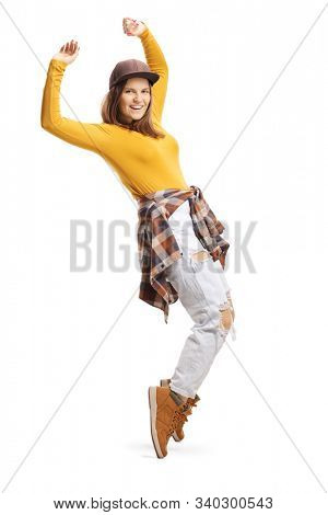 Full length shot of a smiling young female dancing on tiptoes isolated on white background