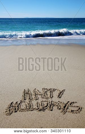 Christmas Words in beach sand. The words