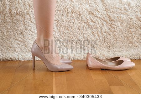 Dilemma, Choosing The Right Pair Of Shoes For A Woman. Girl Chooses Pink, Coral Color Shoes